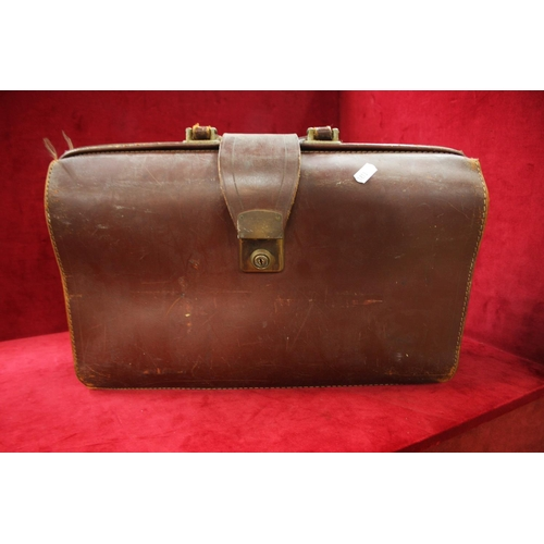 296 - LEATHER BRIEFCASE...