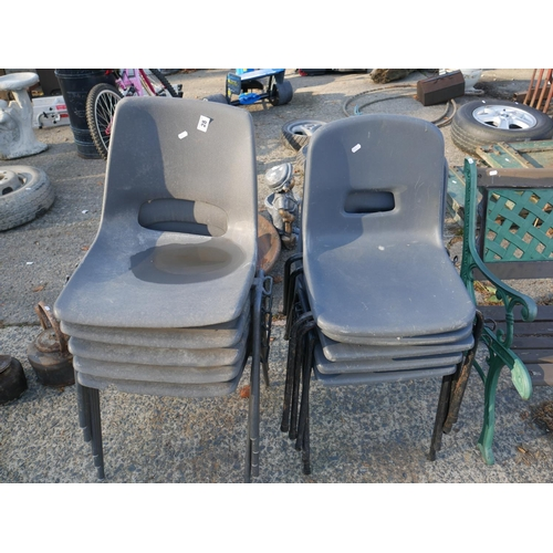 28 - 10 PLASTIC STACKING CHAIRS...