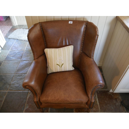 18 - LEATHER WING BACK CHAIR...