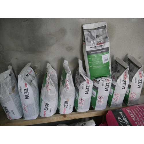 3 - 9 BAGS OF GROUT...