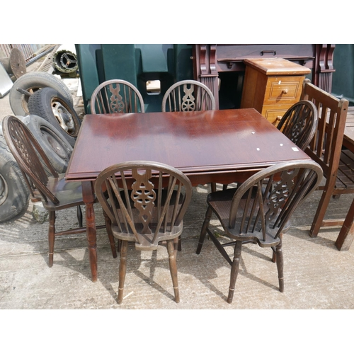 20 - TABLE & 6 WHEEL BACK CHAIRS...