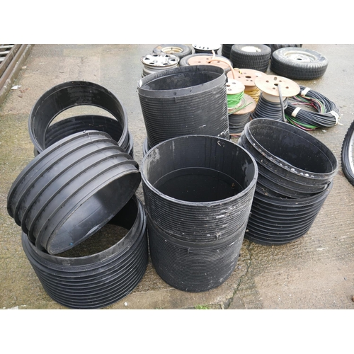 17 - LOT OF MANHOLE RISERS...