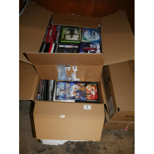 7 - 2 BOXES OF DVDS...