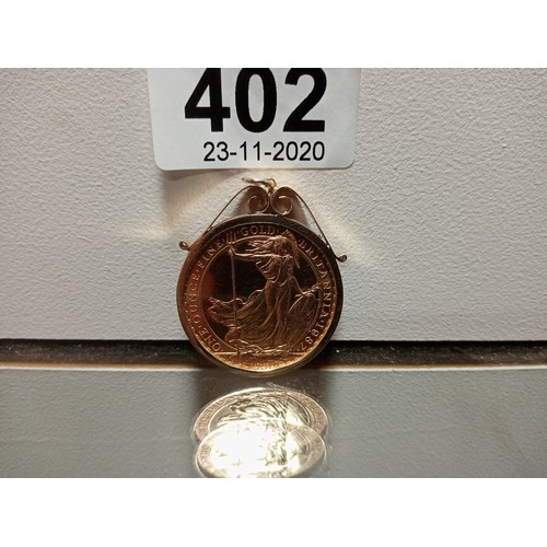 402 - 22CT £100 COIN IN MOUNT...