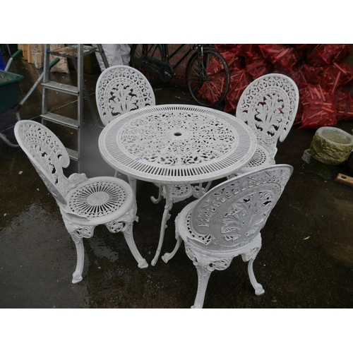 23 - CAST PATIO TABLE & 4 CHAIRS...