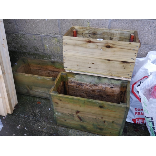 39 - 4 WOODEN PLANTERS...
