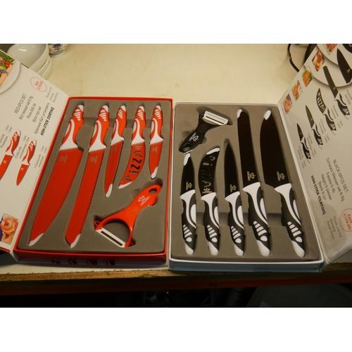 807 - 2 NEW KNIFE SETS...