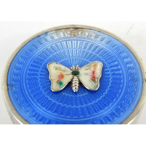 41 - Circular silver blue guilloche enamel pill box with butterfly to the lid, Jieves Ltd, Birmingham 192...
