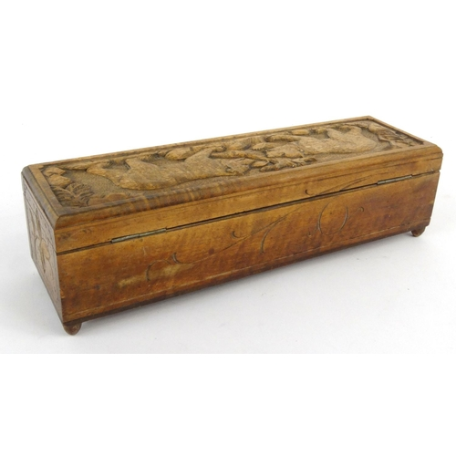 3 - Black Forest wooden glove box carved with bears and lined with a  green buttoned silk interior, 35cm...