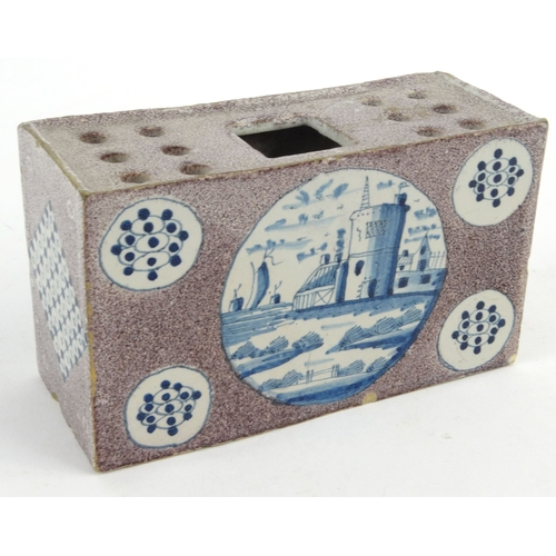 732 - Antique Delft pottery flower brick hand painted with castle scenes, 15cm diameter...