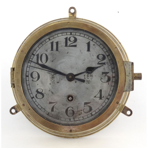 447 - Military interest brass World War II Kriegsmarine U-Boat clock numbered 185, 20cm diameter...