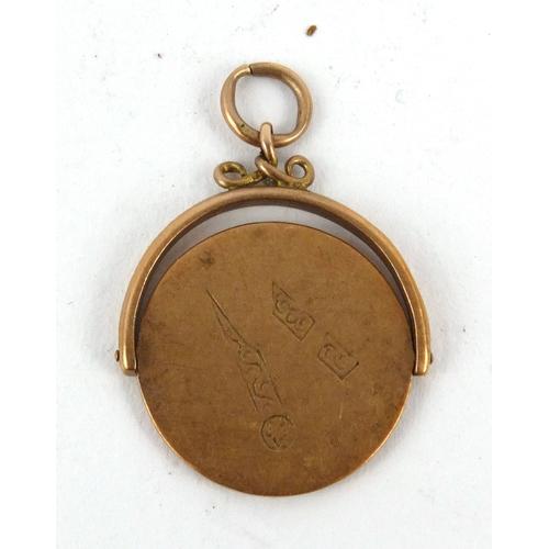 51 - 9ct gold Masonic spinner pendant, 2.5cm high...