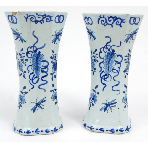 733 - Pair of Dutch Delft pottery vases hand painted with panels sailing boats and flowers, 14.5cm high...