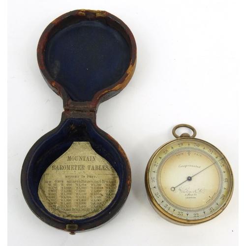 29 - Cased Newton & Co London compensated pocket barometer, 4.7cm diameter...