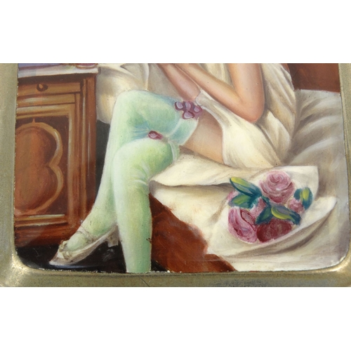 38 - Edwardian silver metal cigarette case decorated with enamelled risqué lady seated on a bed doing her...