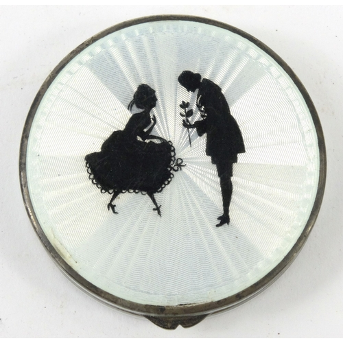39 - Circular silver and guilloche enamelled compact, the lid decorated with a view of a courting couple,...