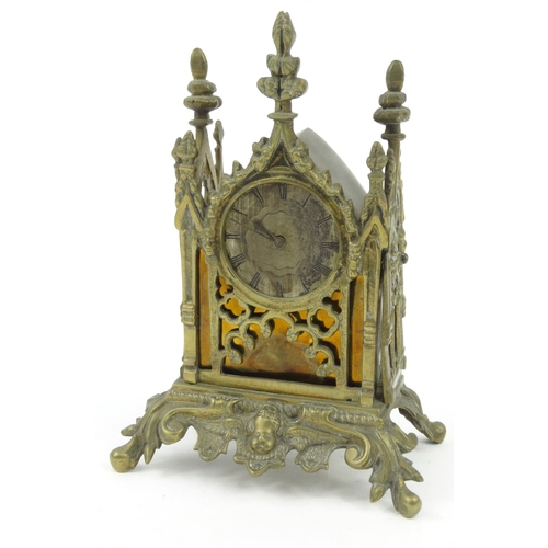 1115 - Brass Gothic style mantel clock, the movement 'Sal Muckasarsie London' to back, 18cm high...