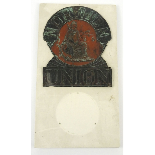 49 - Tin Norwich Union Insurance fire plaque mounted on a wooden board, 27cm x 22cm...