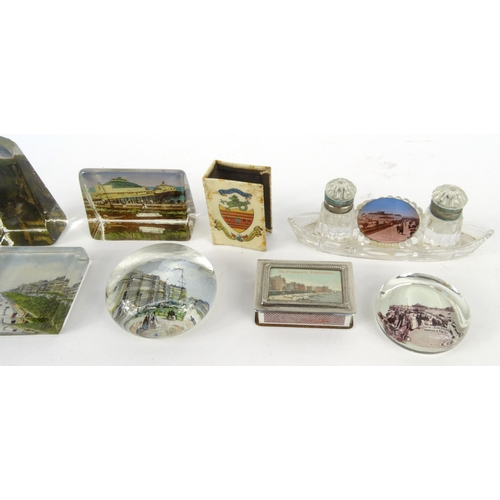 56 - Selection of souvenir glass paperweights from Eastbourne, purse, matchbox holders and a glass ink st...