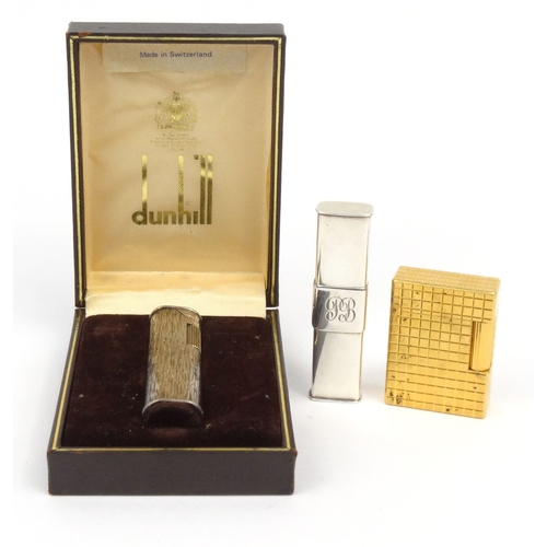 122 - Three lighters comprising boxed Dunhill bark design lighter, silver coloured example and a Dupont ex...