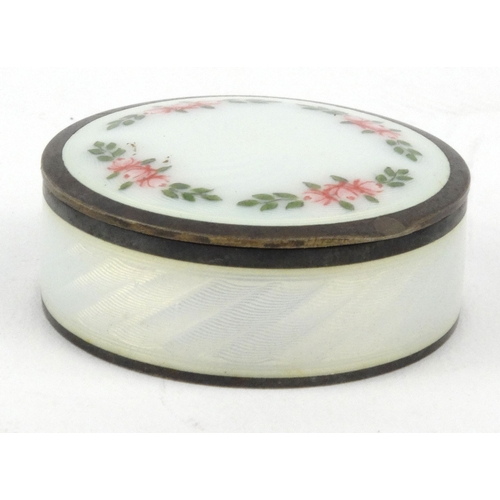 40 - 925 grade silver and guilloche enamel pill box with floral decoration, 1.5cm high...