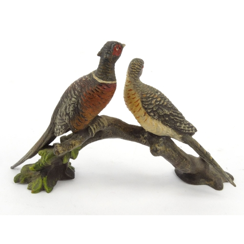 8 - Cold painted bronze of two pheasants on a branch, 9cm high...