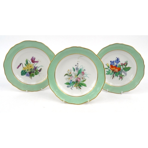 731 - Three Meissen plates hand painted with a floral decoration, crossed swords marks to the base, each 2...