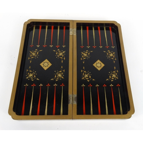604 - Oriental chinese carved ivory chess set together with a folding black lacquered chess/backgammon boa...