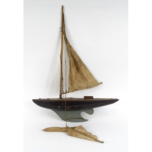 602 - Old wooden pond yacht with cloth sale, 61cm long...