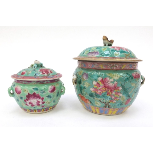 577 - Oriental pot and cover hand painted with floral design with dog of Foo lid, together with a similar ...