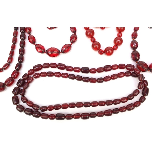 1173 - Five cherry amber coloured bead necklaces, approximate weight 472.5g...