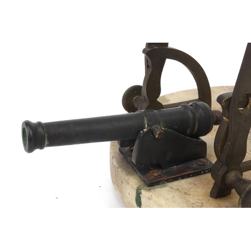 32 - 19th Century marble and bronze noon cannon with hours and co-ordinates, the marble base 20cm diamete...