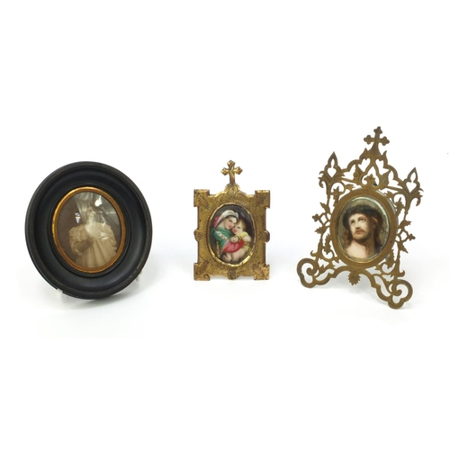 31 - Two continental hand painted porcelain plaques, one of Madonna and child and one of Christ, both hou...