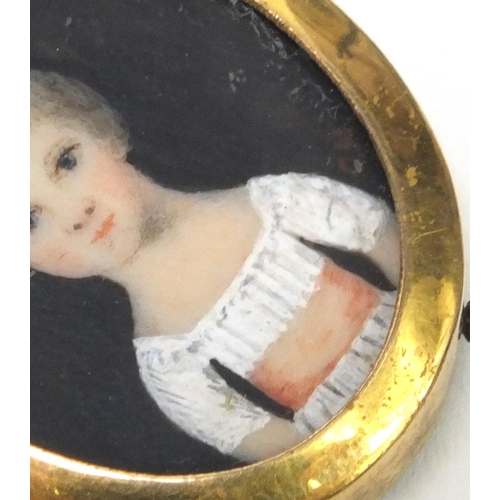 27 - Oval portrait miniature of a child, monogrammed CH, housed in a gilt metal frame, 2.5cm high excludi...