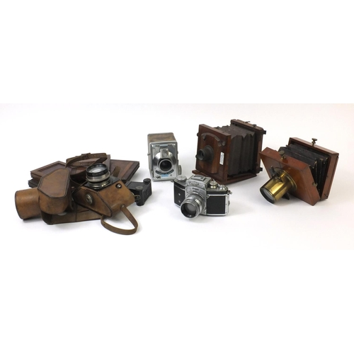 203 - Group of cameras including a Lancaster & Son of Birmingham mahogany plate camera, two Exacta cameras...