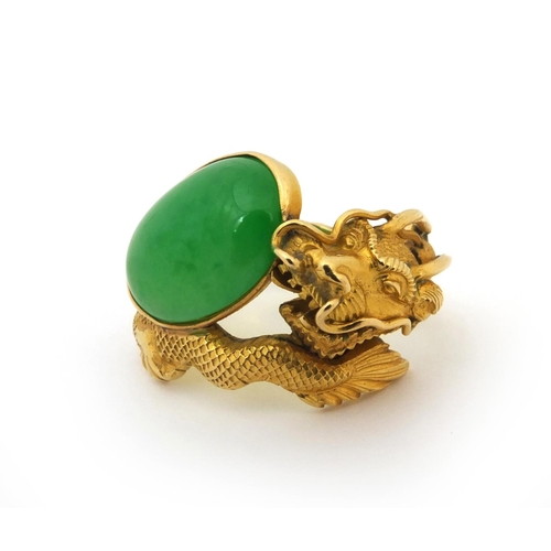 514 - 19th century Chinese 20ct gold and jade ring by Wang Hing, modelled as a dragon chasing a pearl, wit...