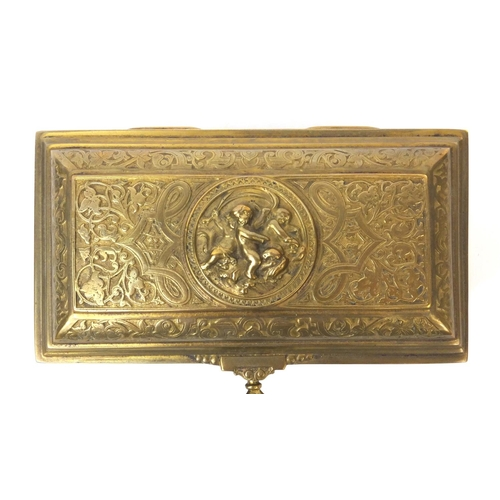 38 - 19th century French brass lockable jewellery casket with red velvet interior, decorated with putti, ...