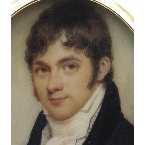 7 - 19th century oval portrait miniature of a gentleman wearing a black coat onto ivory, housed in a gol...
