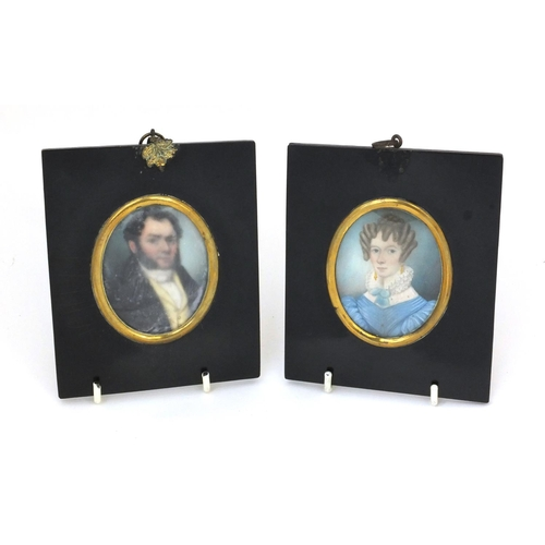 17 - Pair of 19th century oval portrait miniatures, one of a gentleman wearing a black coat the other of ...