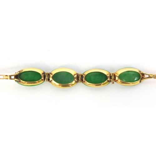 522 - Chinese 9ct gold green jade bracelet, set with four stones, 16cm long, approximate weight 5.0g...