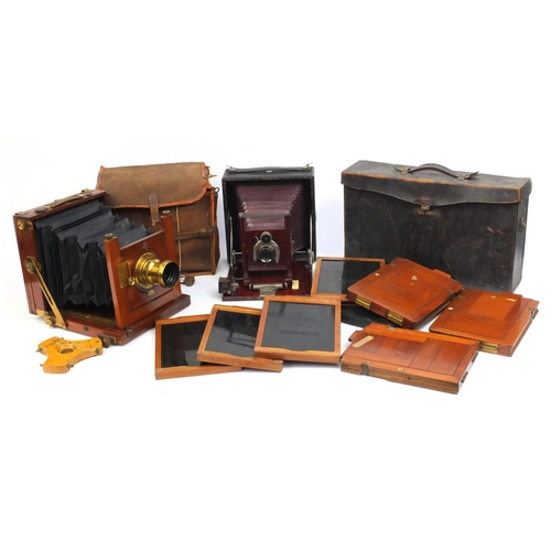204 - Two folding plate cameras comprising a Reynolds & Branson of Leeds mahogany example together with a ...
