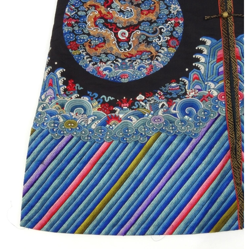 578 - Chinese silk kimono embroidered with roundels of dragons, 121cm high...