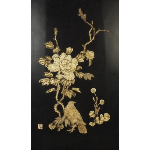 580 - Two Oriental lacquered panels with bone relief decoration, decorated with birds and peonies, both wi...