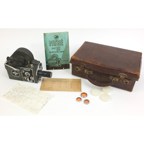 206 - Pathé Super 16mm Webo motion camera, housed in a leather case with instruction booklet, 27cm long...