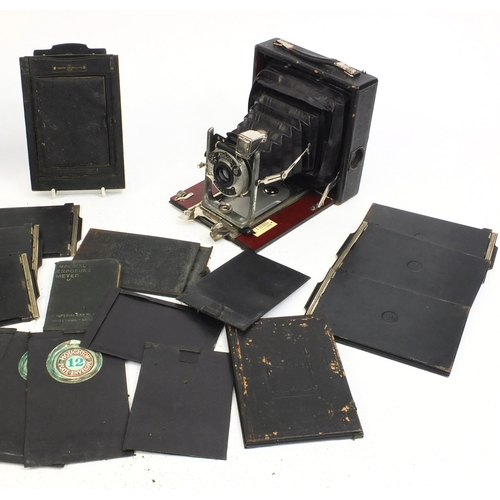 205 - Koilos Patent folding plate camera with metal plates, leather carrying case and a Imperial exposure ...