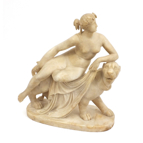 32A - 19th century carved marble figure of Una and the Lion from Spencer's Faerie Queene, 40cm high...