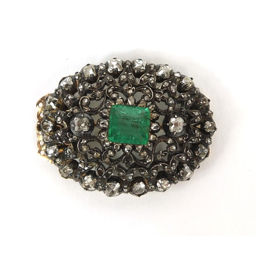 743 - Late 19th/early 20th century Russian diamond brooch set with a central emerald, clasp fitting to the...