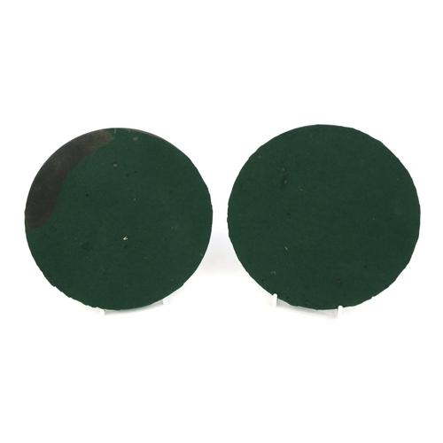 14 - Two Victorian vulcanite plaques of Apollo and St Cecilia, each 15.5cm...