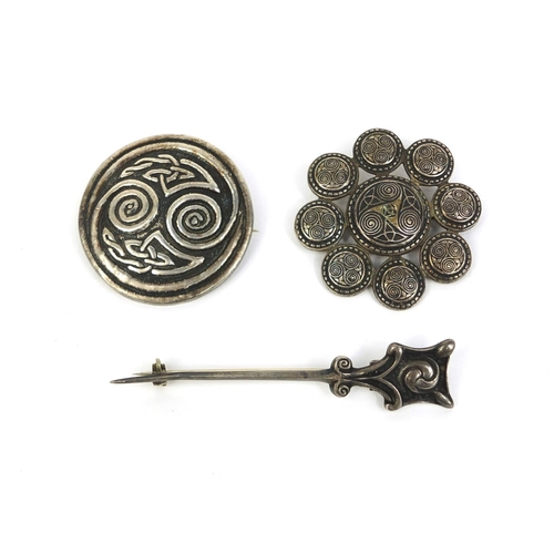 647 - Group of three Scottish Arts & Crafts brooches including two silver Iona examples, the largest 7cm l...