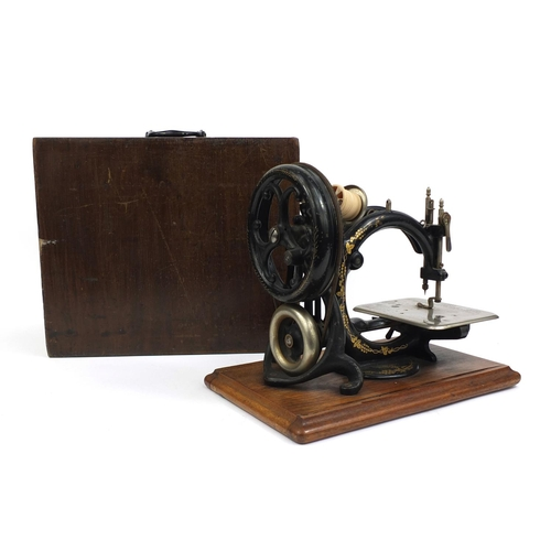 34 - Willcox & Gibbs sewing machine, raised on a plinth base, serial No.A473100, 32cm in length...